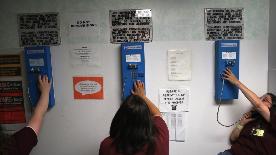 Women make phone calls at the York Community Reintegration Center, a unit in a Connecticut state prison.