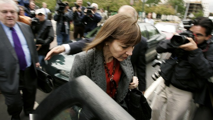 New York Times reporter Judith Miller leaves a federal district court, trailed by her attorney, following a 'Plamegate'-related grand jury appearance in 2005.