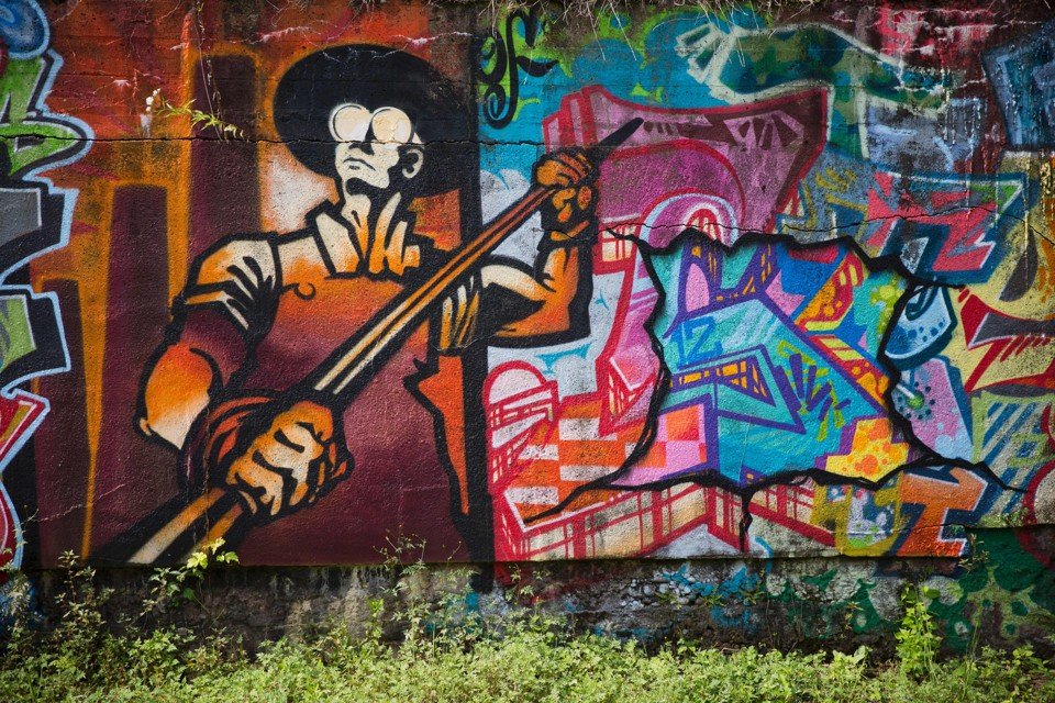 Graffiti, along with the figure of a steelworker, is painted on the side of Carrie Furnace blast furnaces in Rankin, Pennsylvania.