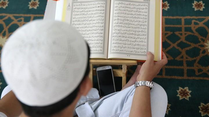A Muslim man reads the Koran at Saigon central mosque in Vietnam.