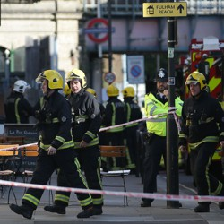Members of the emergency services work outside Parsons Green underground tube station
