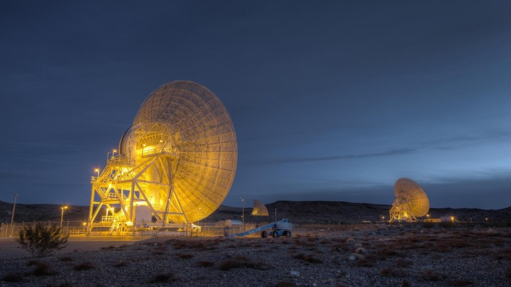 Large satellites in the desert at night