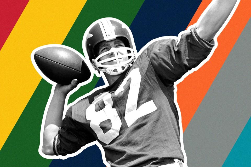 A quarterback gets ready to throw a football