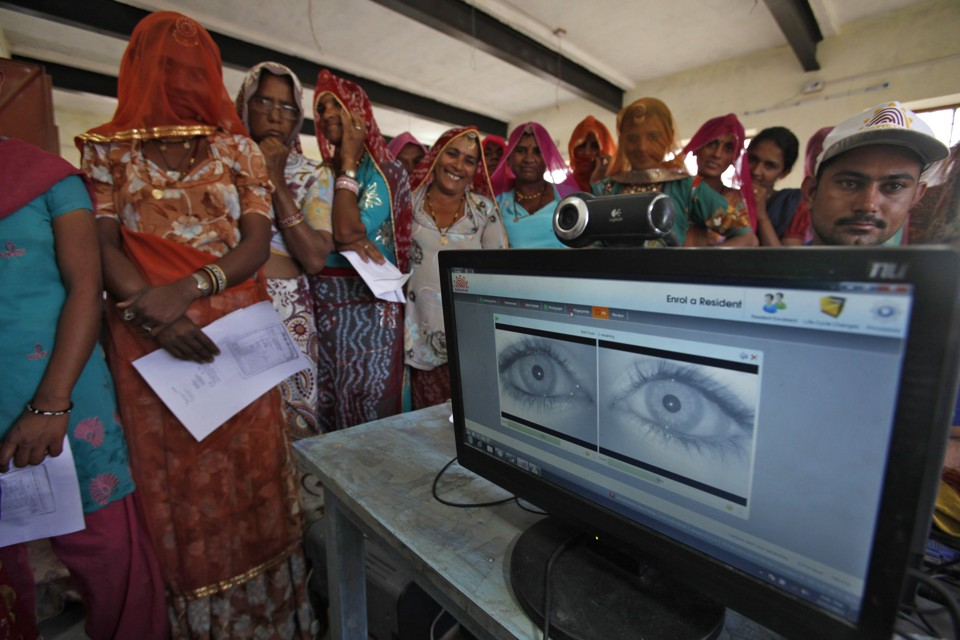 Women stand in a line to enroll in the Unique Identification (UID) database system at Merta district in the desert Indian state of Rajasthan February 22, 2013.