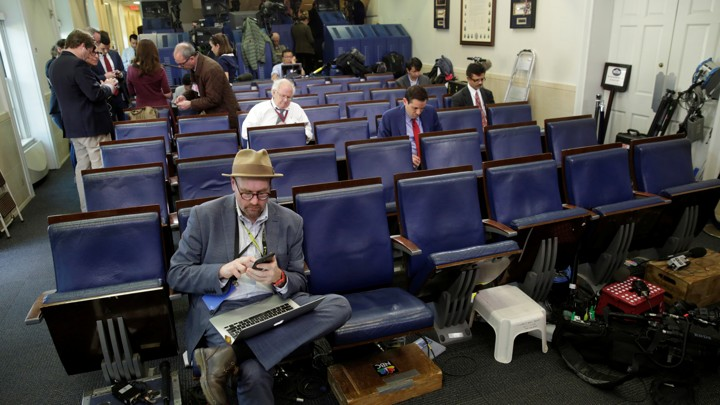 Glenn Thrush works in the White House briefing room