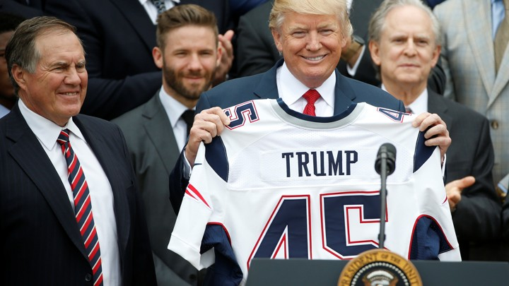 President Trump holds up a New England Patriots jersey during an event honoring the Super Bowl champions at the White House on April 19, 2017
