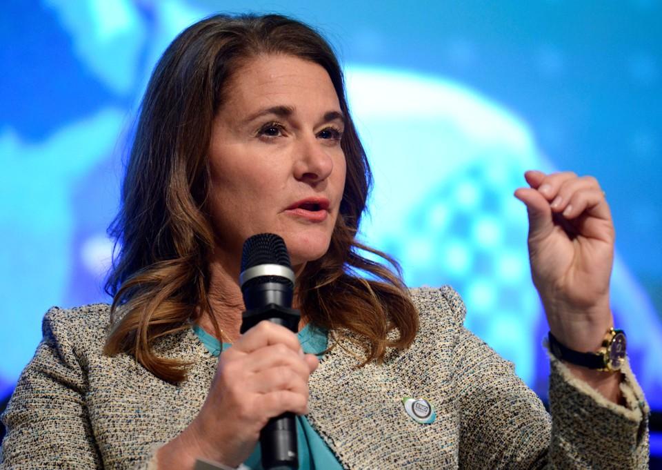Melinda Gates speaks into a microphone.
