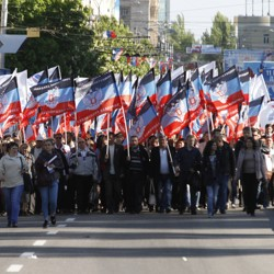 People carry flags of the self-proclaimed Donetsk People's Republic.