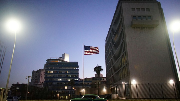 A car drives past the U.S. Embassy in Havana