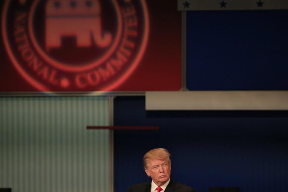 President Donald Trump looks sideways.