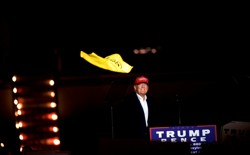 "Donald Trump throws a Pittsburgh Steelers ""Terrible Towel"" at a rally in Pennsylvania in November 2016."