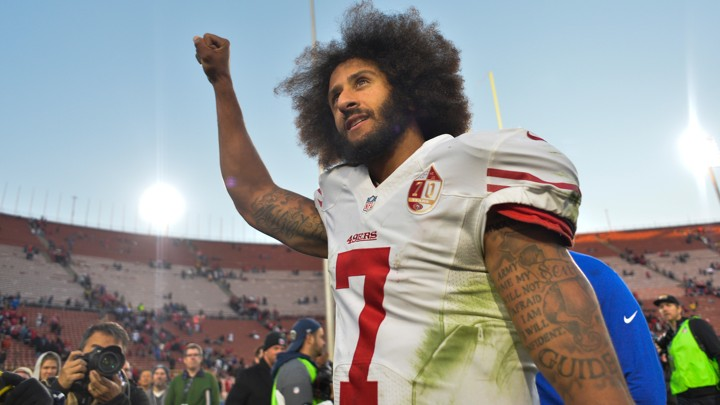 Colin Kaepernick raises a fist after a 49ers win in December 2016