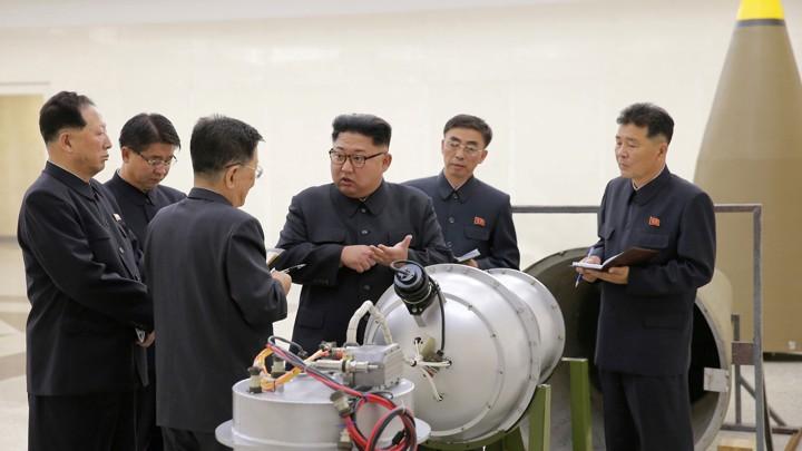Kim Jong Un talks to his scientists