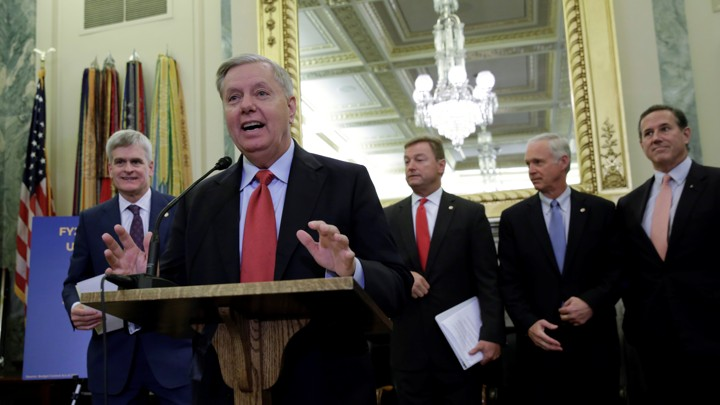 Senator Lindsey Graham leads a group of Republicans introducing an Obamacare-repeal plan.