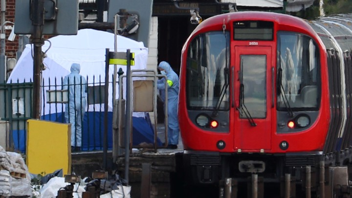 Authorities search the Parsons Green tube station platform in London following an explosion on September 15, 2017.