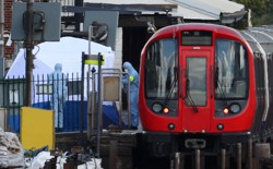 Authorities search the Parsons Green tube station platform in London following an explosion onSeptember 15, 2017.