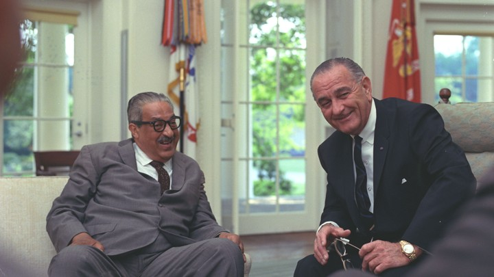 Thurgood Marshall sits with President Lyndon Johnson in the White House