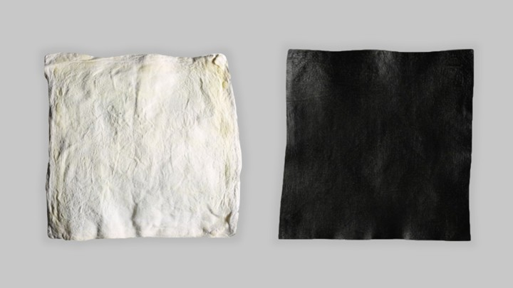 A square of white raw hide and a square of black dyed hide