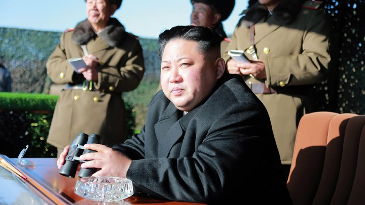 Kim Jong Un holds binoculars