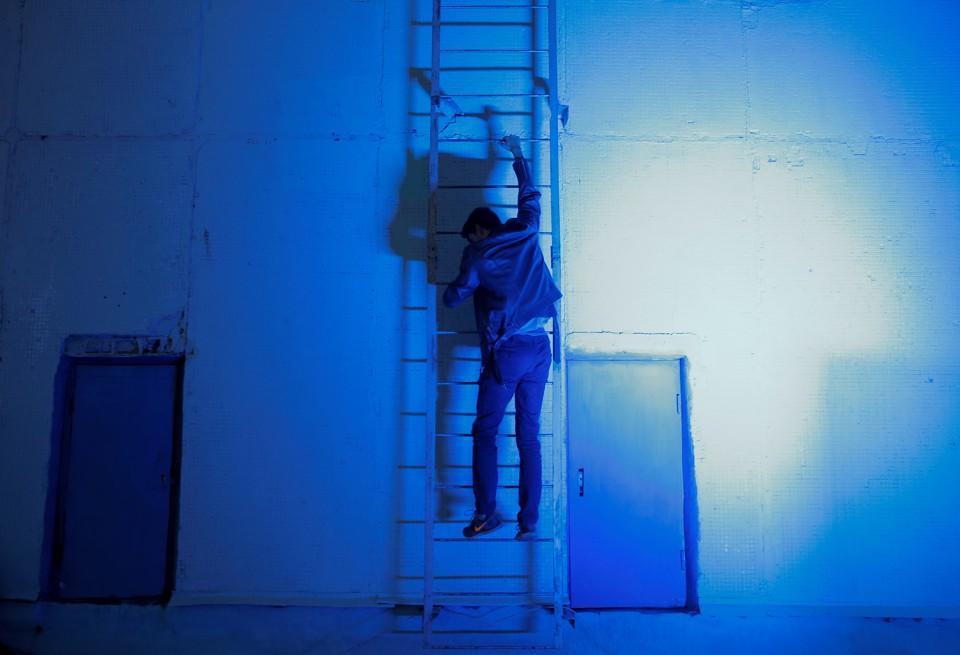 A man climbs a ladder.