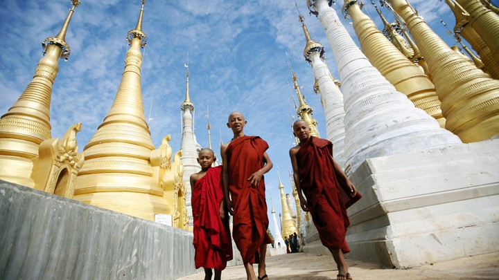 Buddhist monks walk through the Shwe Indein Pagoda near Inle lake in Myanmar.