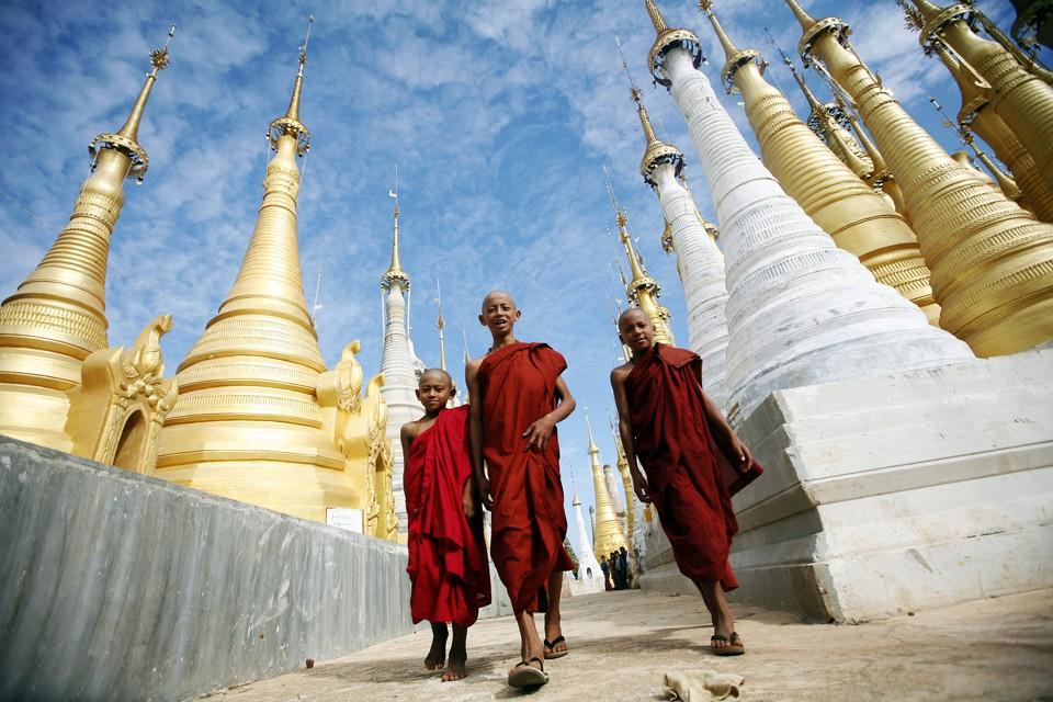 Buddhist monks walk through the Shwe Indein Pagoda near Inle lake in Myanmar.