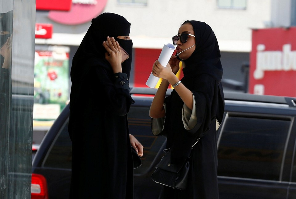 Saudi women speak on their phones in Riyadh.