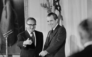 Secretary of State Henry Kissinger and President Richard Nixon in the East Room of the White House.
