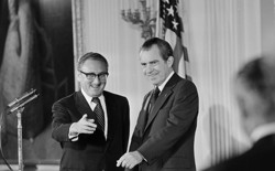 Secretary of State Henry Kissinger and President Richard Nixon in the East Room of the White House.