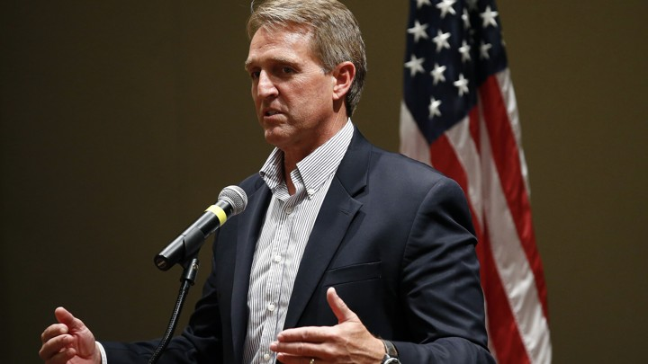 Senator Jeff Flake speaking into a microphone
