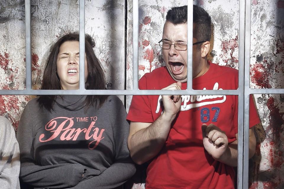 Visitors react at a haunted house.