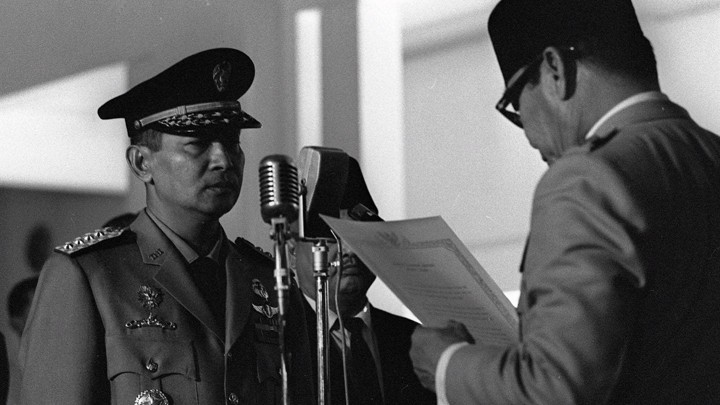 General Suharto being sworn into the Indonesian Cabinet by President Sukarno