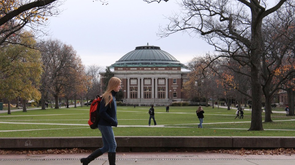 Students walk across the campus of the University of Illinois at Urbana-Champaign.