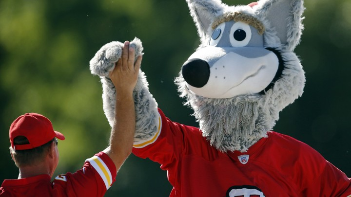 KC Wolf and a Kansas City Chiefs fan