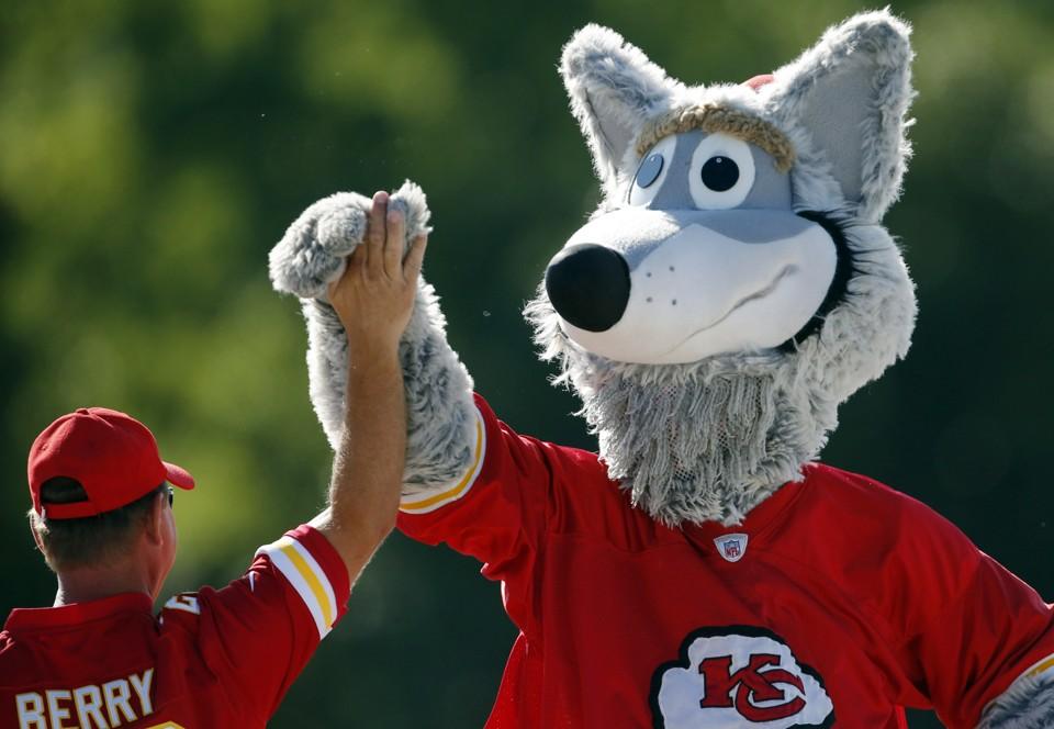 KC Wolf and a Kansas City Chiefs fan