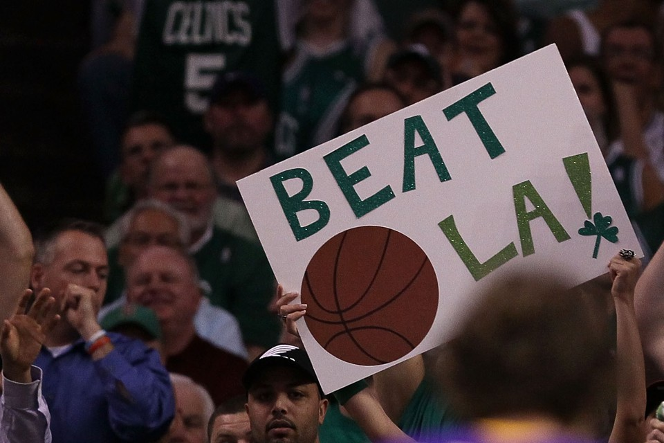 Fans of the Boston Celtics hold a 'Beat L.A.!' sign
