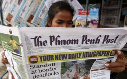 A woman reads The Phnom Penh Post in Cambodia