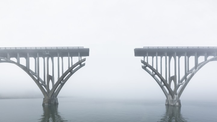 An unconnected bridge over water