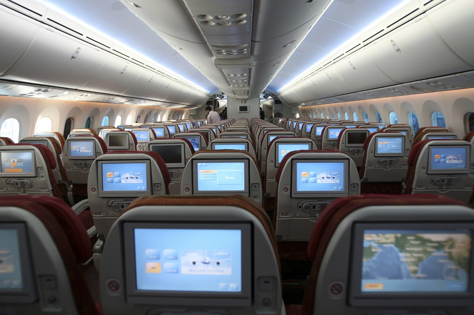 Rows of airplane seats viewed from behind