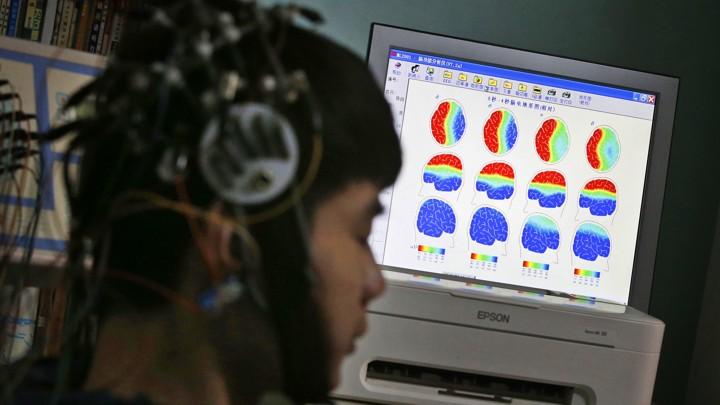 A person participates in a brain-imaging study.