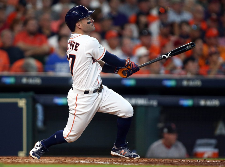 The Houston Astros second baseman Jose Altuve hits a solo home run during the fifth inning against the Boston Red Sox in game one of the 2017 ALDS playoff baseball series at Minute Maid Park.