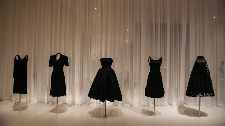 Little black dresses on display on mannequins