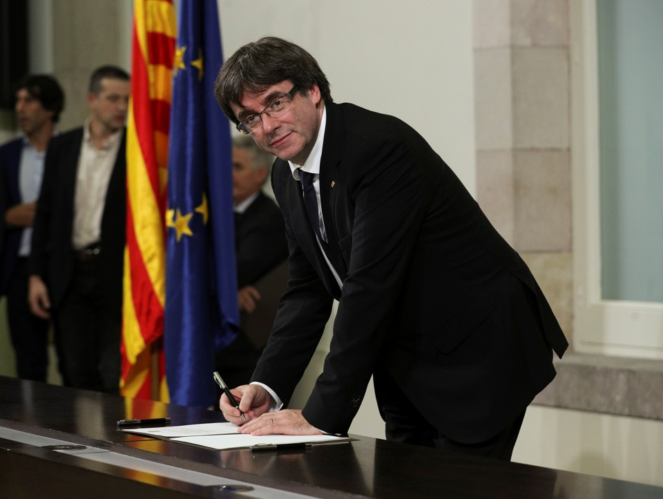 Catalan President Carles Puigdemont signs the Catalan declaration of independence.