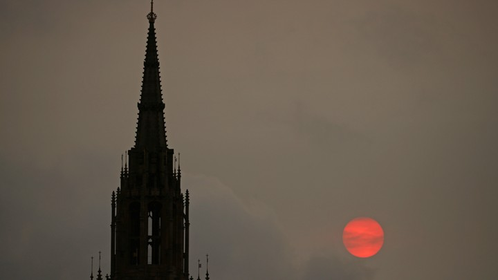 The sun sets behind the Houses of Parliament in London on October 16, 2017.