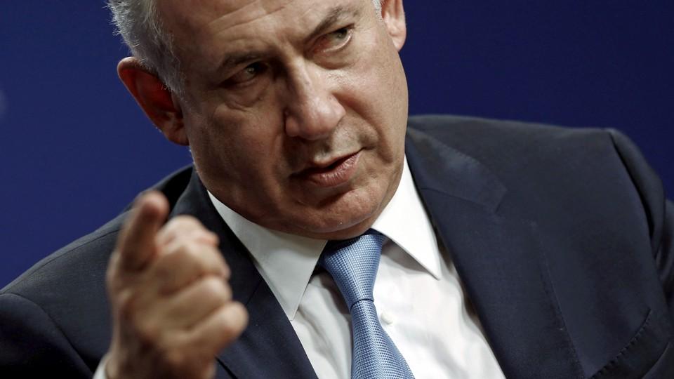 Prime Minister Benjamin Netanyahu  waves a finger menacingly.