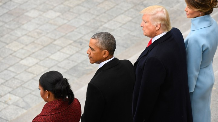 Michelle Obama, Barack Obama, Donald Trump, and Melania Trump stand together.