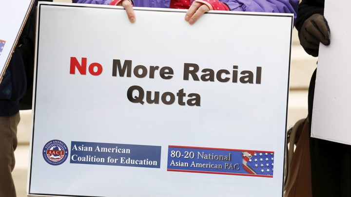 "A sign says ""No More Racial Quota"""