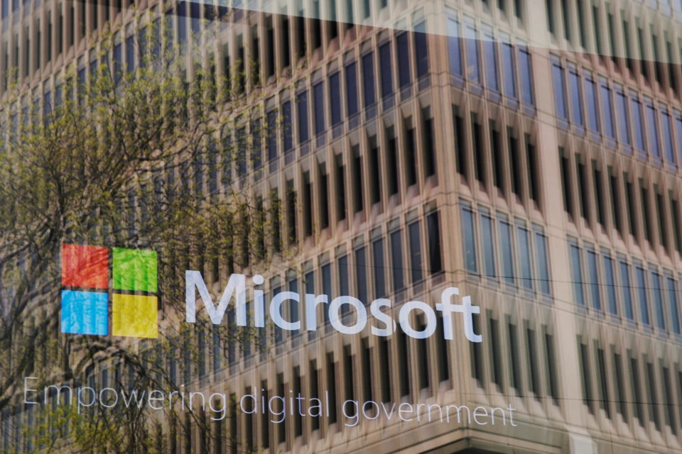 The Microsoft logo reflected in a window