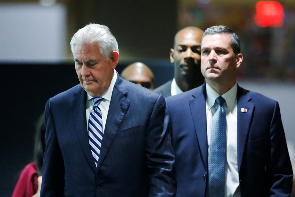 Secretary of State Rex Tillerson exits a meeting.