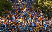 Pro-independence protesters wave Catalan flags